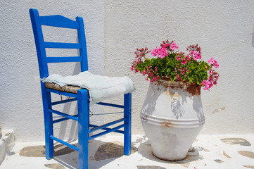 Traditional blue greek chair against white wall