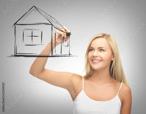 woman drawing house on virtual screen