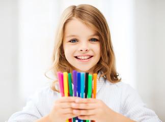 girl showing colorful felt-tip pens