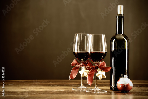 Fotobehang Bar Red wine, bottle and christmas baubel