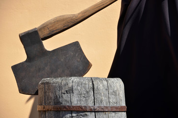 Headsman's axe hewed in old wooden chunk