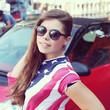 Pretty American girl in American flag t-shirt. Portrait outdoors