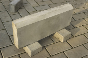 One large curb stone is made of concrete
