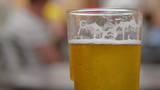 beer glass at street cafe with shallow depth of field