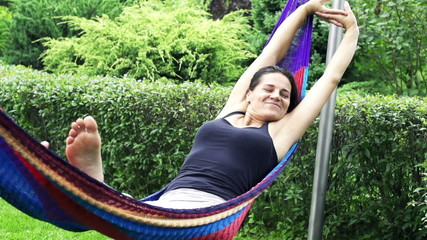 Sleepy woman swinging in a hammock, slow motion shot at 240fps