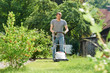 man mowing lawn in backyard