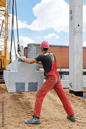 worker installing concrete slab