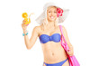 Attractive blond woman in bikini holding a cocktail