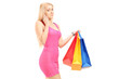 Attractive woman with shopping bags, talking on a mobile phone