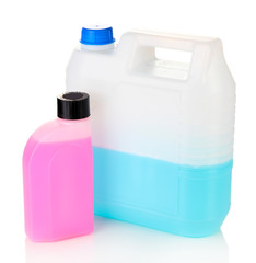 Blue and pink liquids for car in canisters isolated on white
