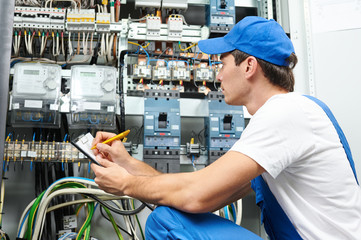 electrician worker inspecting