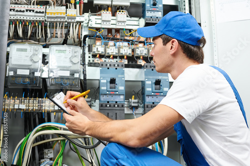 electrician worker inspecting - 55571760