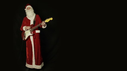 Santa Claus playing a guitar