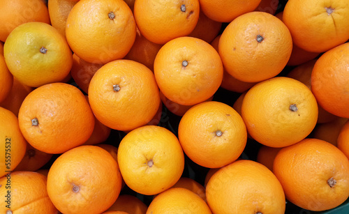 many fresh raw orange display at market