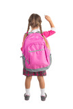 Little girl in pink school uniform with a backpack