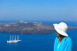 woman enjoying view of Santorini, Greece