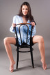 Young elegant woman on chair