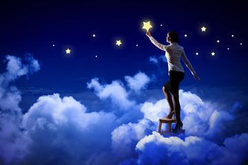 Woman lighting stars