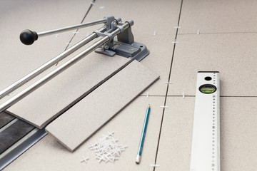 Instruments for installing tiles on floor
