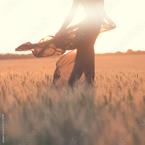 silhouette of woman body in the field