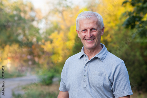 portrait of happy smiling face of grey-haired old man