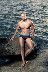 smilling bodybuilder on seashore