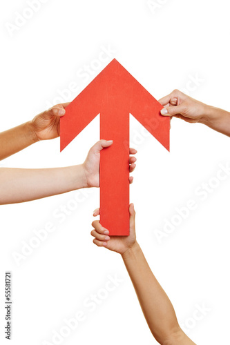Hands holding red arrow