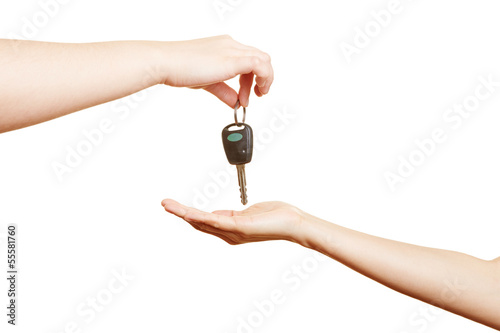 Hand offering car keys