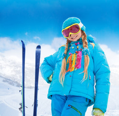Happy girl with her mountain skis