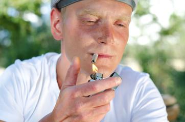 Portait of a smoker lighting a cigarette