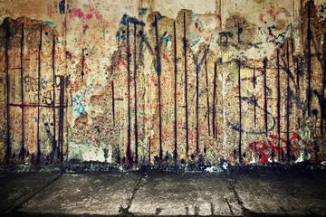 Grunge, rusty concrete wall with random graffiti