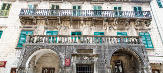 Green Shutters on Ancient Building in Kotor
