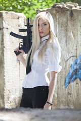 blond woman with automatic gun