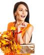Woman holding  orange leaf and handbag.