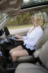 Female motorist working in her car
