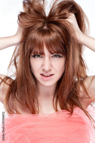Girl portrait of angry and shoot the breeze at his hair
