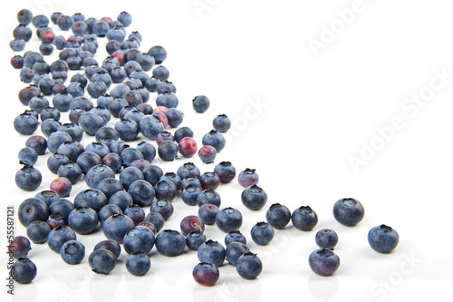 Spilling on the table blueberries