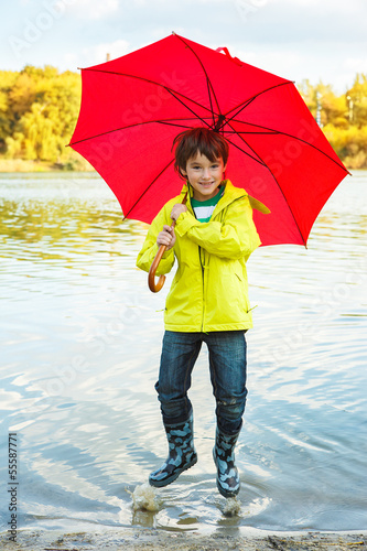 Boy hopping in water