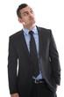 Skeptiker - Geschäftsmann isoliert im Anzug blickt nach oben