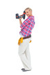 Woman standing with a power drill