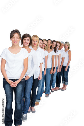 Cheerful casual models posing in a line