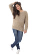 Thoughtful Young Woman Wearing Jeans and a Woolen Jumper