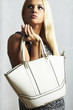 fashionable beautiful blond woman with handbag. shopping