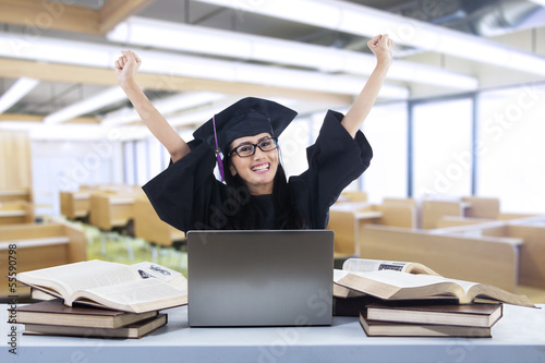 Happy graduate laughing in class