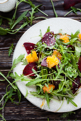 fresh salad with arugula, orange and beetroot