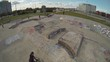 Aerial of BMXer Tricks in Skatepark