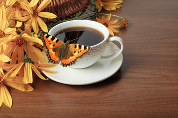 Coffee, butterfly and flowers