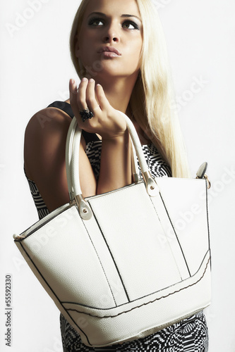 isolated beautiful blond woman with handbag. shopping