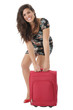 Model Released. Attractive Young Woman Lifting Heavy Suitcase