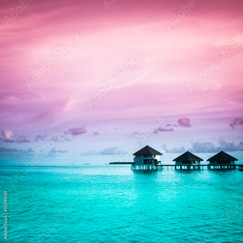 Poster Oceanië Over water bungalows with steps into amazing green lagoon